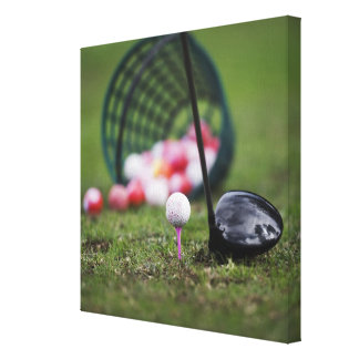 Golf ball on tee beside golf club gallery wrapped canvas