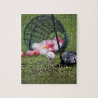 Golf ball on tee beside golf club jigsaw puzzle