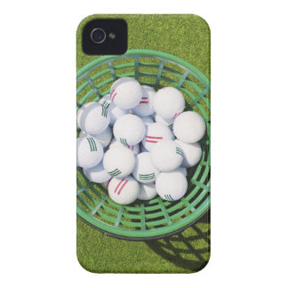 Golf balls in a basket sitting on short green Case-Mate iPhone 4 cases