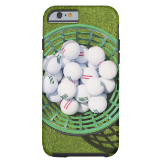 Golf balls in a basket sitting on short green tough iPhone 6 case