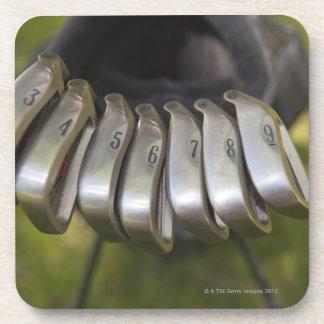 Golf club heads in a bag. Three through nine Coaster