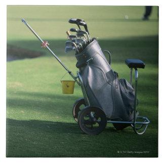 Golf clubs and golf bag tile