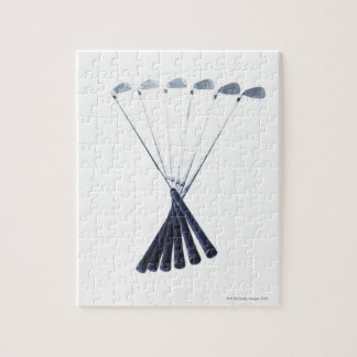 Golf clubs on white background jigsaw puzzle