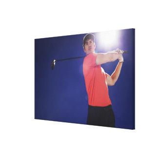 Golf player swinging club canvas print