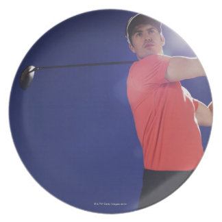 Golf player swinging club plate