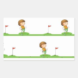 Golf playing boy rectangular sticker