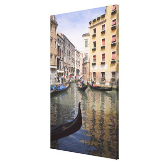 Gondolas in a canal Venice Italy Gallery Wrapped Canvas