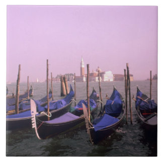 Gondolas ready for tourists in Venice Italy Tile