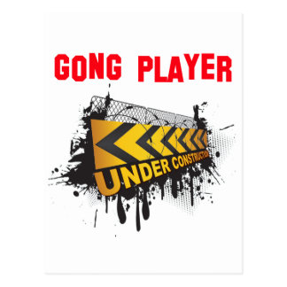 Gong player under construction postcard
