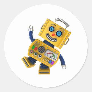 Goofy yellow toy robot classic round sticker