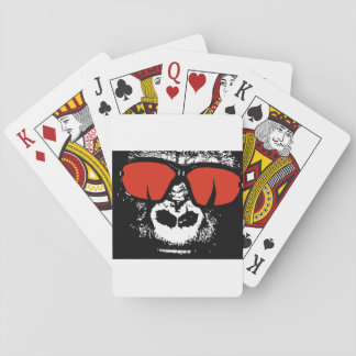 Gorilla with glasses playing cards