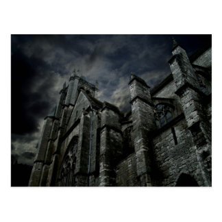 Gothic cathedral with a gloomy dark sky postcard