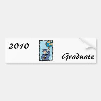 Graduate holding up the world car bumper sticker