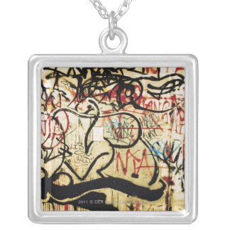Graffiti on a wall silver plated necklace