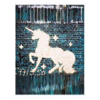Graffiti Unicorn on Blue Brick Wall Postcard