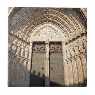 Grand wooden doorway to cathedral in Toledo Tile