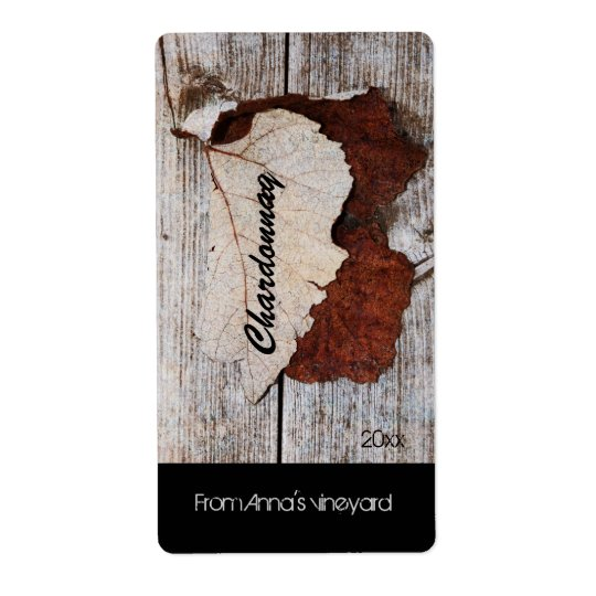 grape leaf on wooden board wine bottle label