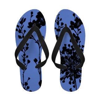Graphic black and blue floral print flip flops