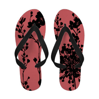 Graphic black and coral floral print flip flops