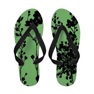 Graphic black and green floral print flip flops