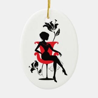 Graphic silhouette of a woman sitting in red chair ceramic oval decoration