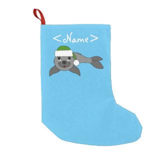 Gray Baby Seal with Christmas Green Santa Hat