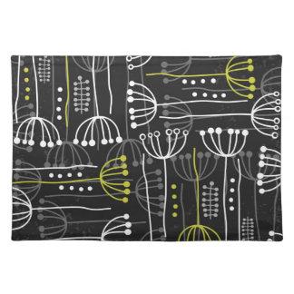 gray green botanical pattern on dark placemat