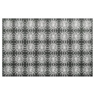 Gray spinning stars energetic pattern black fabric
