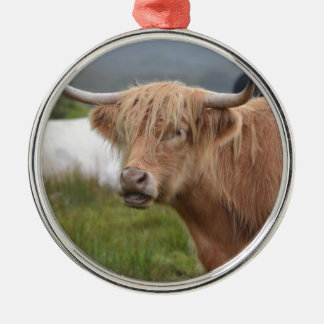 Grazing Highland Cow Round Metal Christmas Ornament