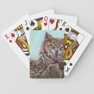 Great horned owl and chick playing cards