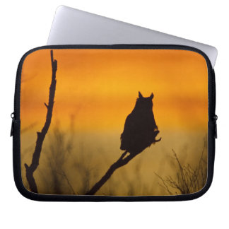 Great Horned Owl perched at sunset Laptop Sleeves
