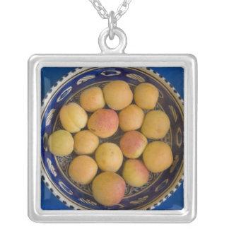 Greece, Crete. A bowl of Mediterranean Square Pendant Necklace