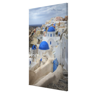 Greece, Santorini. Bell tower and blue domes of 3 Canvas Print