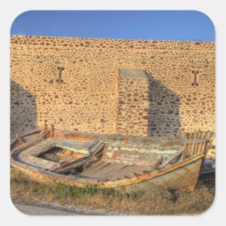 Greece, Santorini, Oia. Old fishing boat on dry Square Sticker