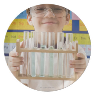 Greek boy holding rack of test tubes plate