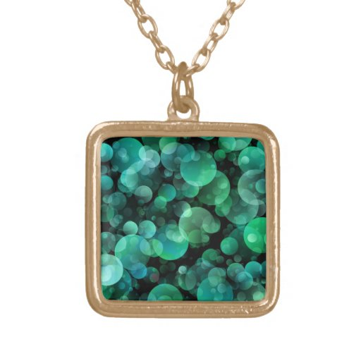 Green and Blue Circle Bubbles over a Black Jewelry