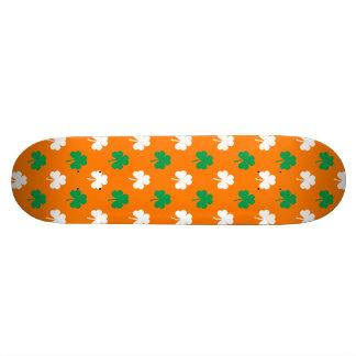 Green And White Heart-Shaped Shamrock On Orange Skateboard Deck