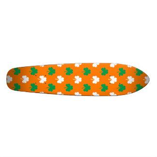 Green And White Heart-Shaped Shamrock On Orange Skateboards