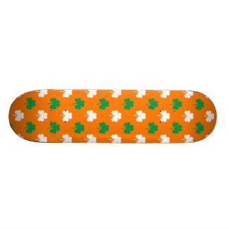 Green And White Heart-Shaped Shamrock On Orange Skate Board Deck