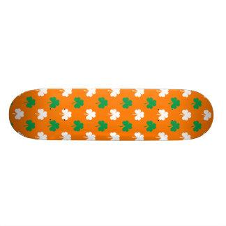 Green And White Heart-Shaped Shamrock On Orange Skateboard