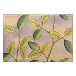 Green and Yellow Leaves on Sunset Background Placemat