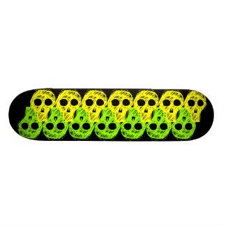 green and yellow Skulls in a collumn black back Skateboard Decks