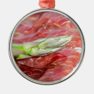 Green asparagus with ham macro Silver-Colored round decoration