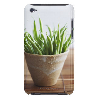 Green beans in pot on bamboo surface iPod touch case