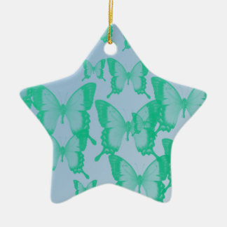green butterflies in blue background christmas ornament
