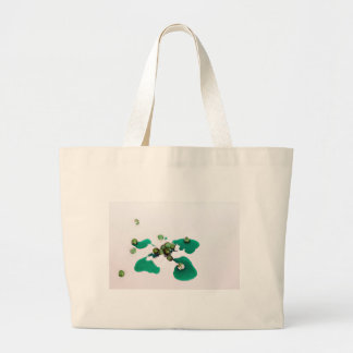 Green candied cherries syrup on icing sugar canvas bags