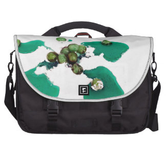 Green candied cherries syrup on icing sugar laptop bags