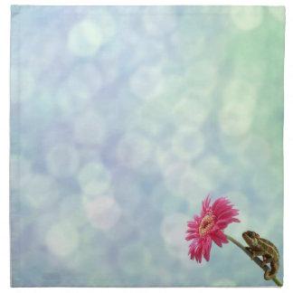 Green chameleon on pink flower napkin