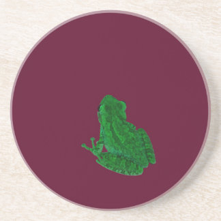 green colorized frong against burgundy coaster