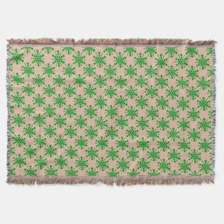 Green dotted star on taupe throw blanket